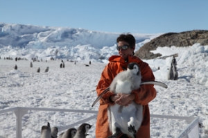 Stephanie Jenourvrier with emperor penguin chick